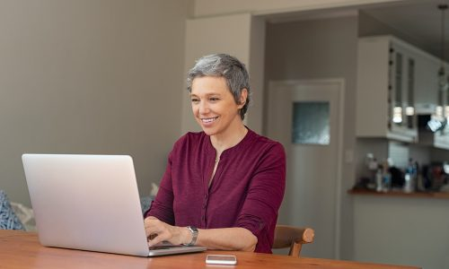 Senior woman using laptop